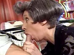 Aged secretary takes in mouth n ass