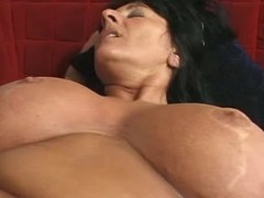 Busty brunette mature fucks on sofa