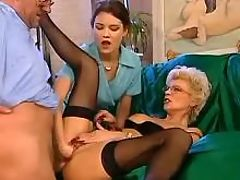 Tempting milf in FFM orgy