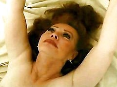 Redhaired mature has a fun on bed in all positions